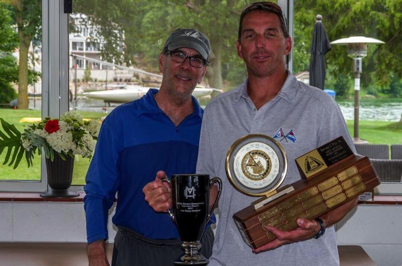 Dan Guidinger (right) collecting the hardware at the MC Masters Regatta at Cedar Lake Yacht Club, WI.